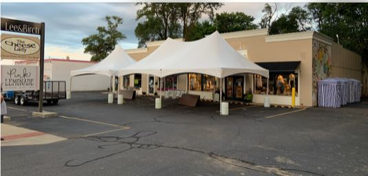 20 x 20 White Frame Tent on the left and a 20 x 30 White Frame Tent on the right