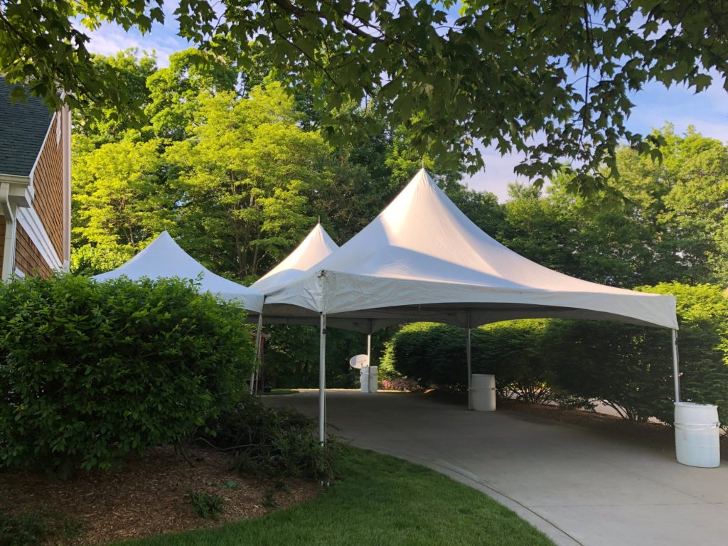 20 x 40 White Frame Tent in front with a smaller 10 x 10 white frame tent in back to the left