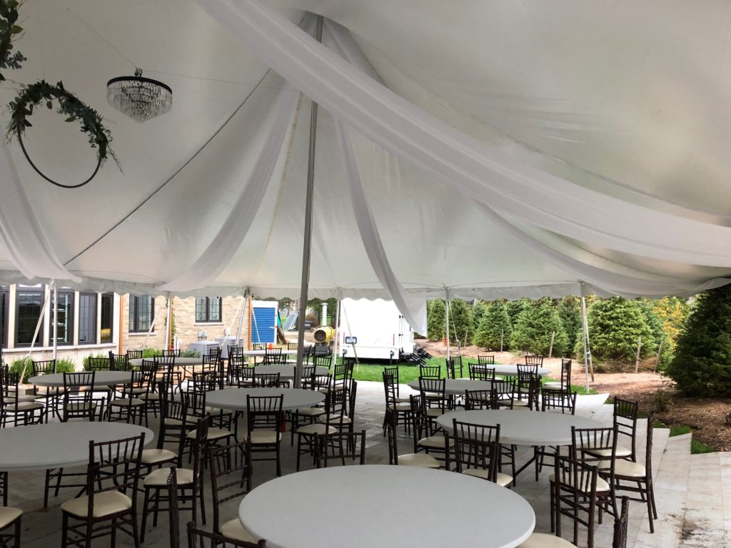 Bride decorated under our 40 x 80 White Tension Tent (we do not own these tables or chairs)